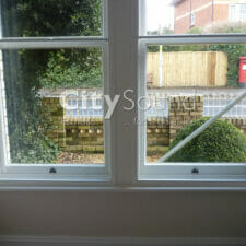 40. Box bay window fitted with secondary sash windows (London)