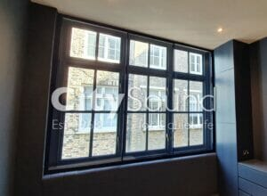 05. Striking blue framed sliders fitted in the high specification residential refurbishment (Liverpool Street, London)