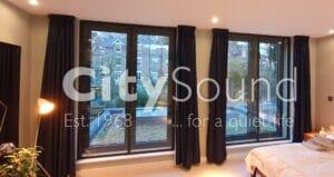 07. Double casement doors in dark grey frames, Noise Reduction (Southbank, London)