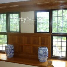 10. Casement (hinge) windows in brown frames fitted in Garde II Tudor period property in Surbiton; Thewrmal Insulation
