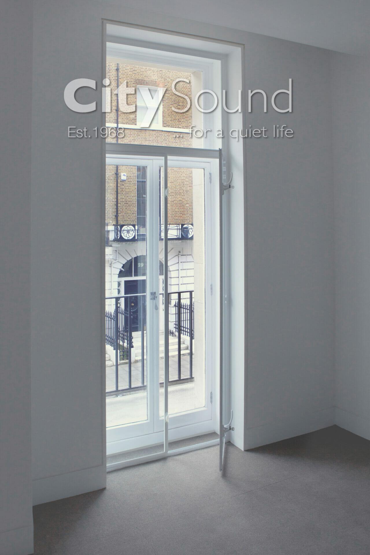 11. Casement (hinge) doors fitting over original balcony doors; Noise reduction (Marylebone, London)