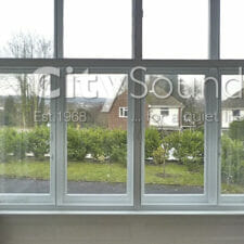 18. Sliding windows fitted to cover this box bay window. (Finchley, London)