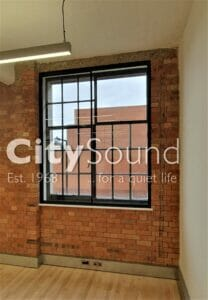 18.1 Black sliding windows fitted to Crittal windows for noise reduction (Metalbox factory, London Bridge)