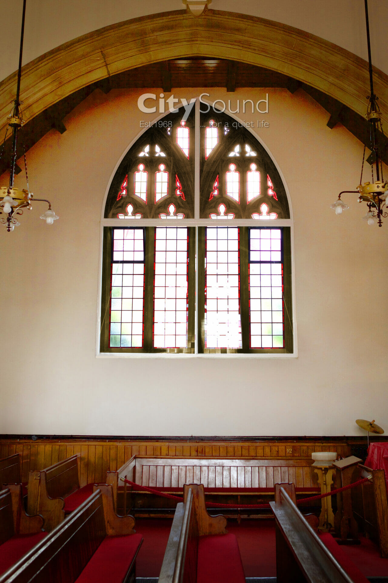 20. Sliding windows and gothic arches done in a Church. For thermal insulation (London)