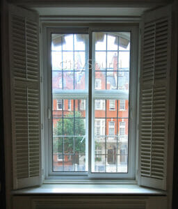 03. Commercial secondary glazing (Sliding widows) fitted. Glazed with thick acoustic glass for noise reduction (Sloane Square, London)