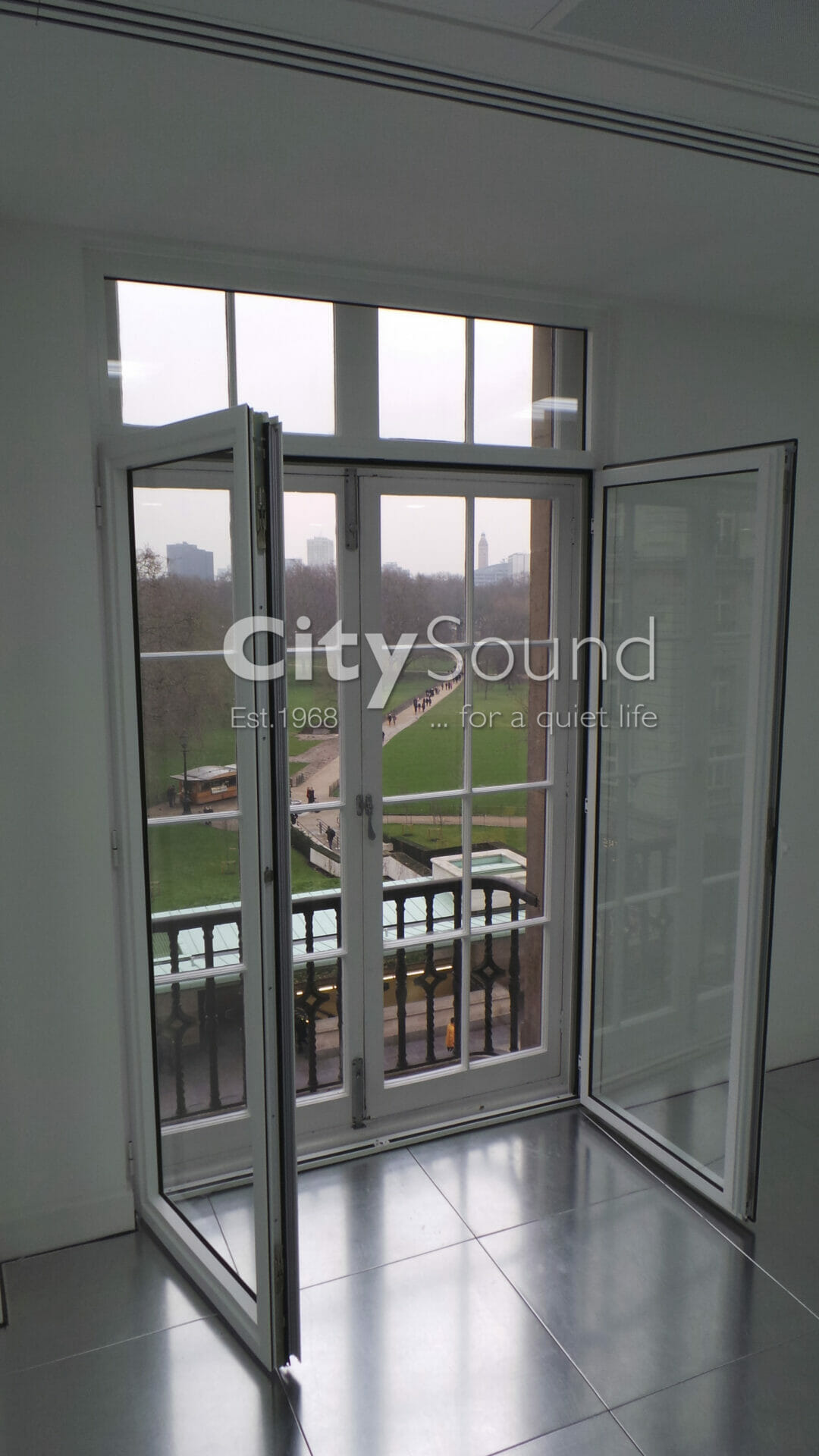 06. Commercial secondary glazing (Double doors) fitted. Glazed with thick acoustic glass for noise reduction (Mayfair, London)